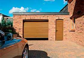 Ворота гаражные секционные стальные двустенные LPU 42 S-гофр Woodgrain - Hörmann